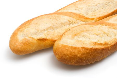 Closeup view of two french bread baguettes on a white background