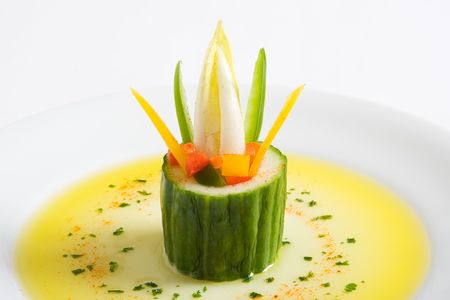 starter: A cucumber vegetarian starter with olive oil on a white plate Stock Photo