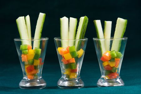 Three appetizer glasses filled with sliced vegetables Stock Photo