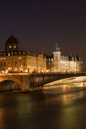 jailhouse: Night view of the Conciergerie (old medieval jailhouse) and the Seine river - Paris, France Stock Photo
