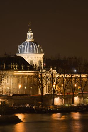 The French Institute and the Seine river at night - Paris, France Stock Photo