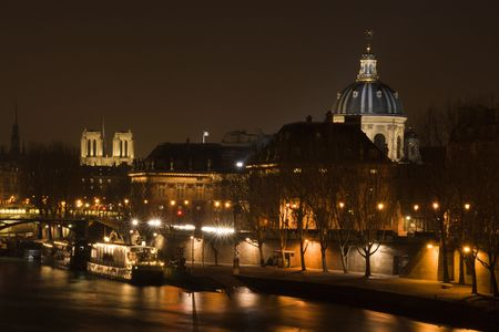 Night view of the Seine river, Notre-Dame cathedral and the French Institute - Paris, France photo