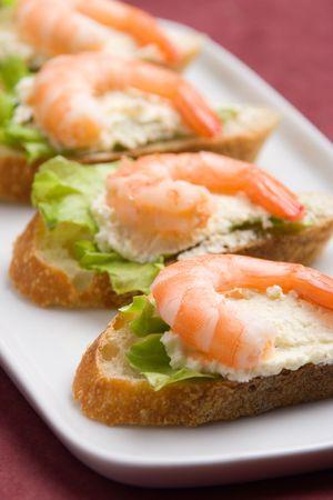 gambas: Closeup view of shrimp toasts with salad and garlic cheese (shallow DOF)