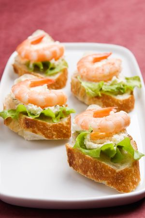 Closeup view of shrimp toasts with salad and garlic cheese (shallow DOF) photo