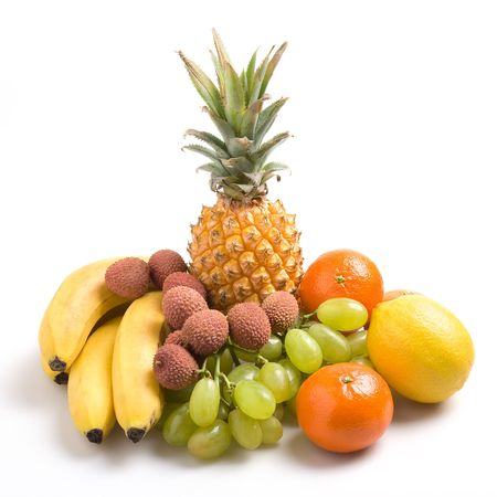 Various fresh fruits on a white background photo