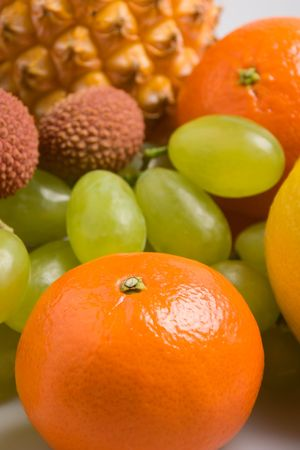 Closeup view of a tangerine in front of other fruits (shallow DOF) Stock Photo - 755758
