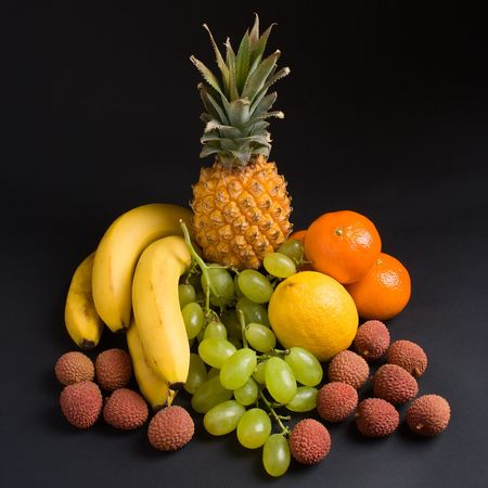 Various fresh fruits on a dark background photo