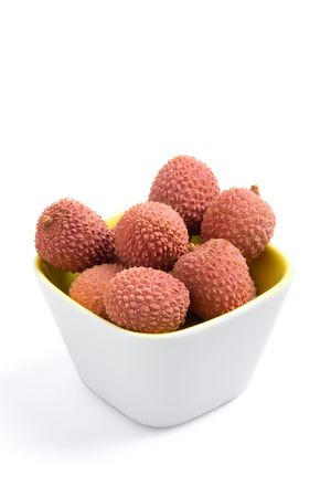 litchee: Fresh litchis in a cup on a white background Stock Photo