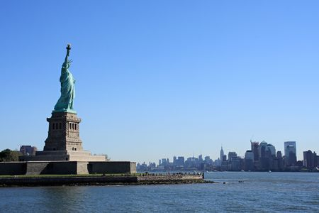 liberty island: Lady Liberty on Liberty Island, with Manhattan in the background - New York City, USA Stock Photo