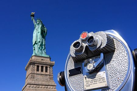 long range: Statue of Liberty with long range binoculars in the foreground - New York City, USA