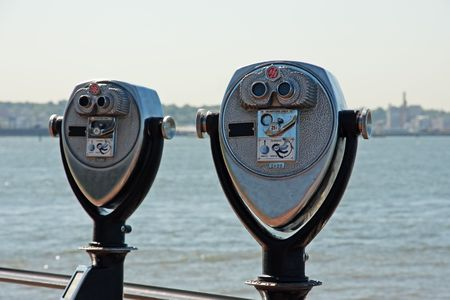 long range: Long range binoculars - Liberty Island, New York City, USA (focus on the foremost binoculars)