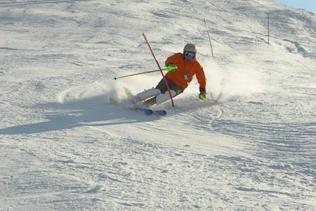 flank: Mountain-skier sliding on the flank of hill