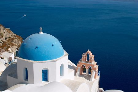 mediterranian: Church in Oia Santorini in front of the Mediterranian sea