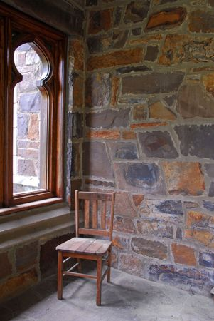 Wooden Chair on Stone Porch Stock Photo