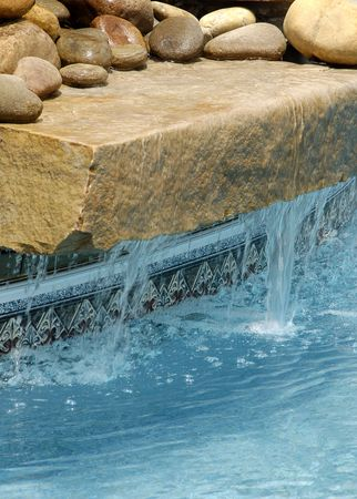 water feature: Swimming Pool Water Feature Stock Photo