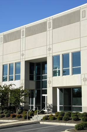 Front Facade of New Commercial Office Building Stock Photo