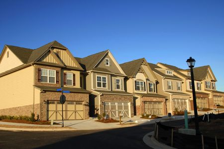 townhouses: Early Morning Sunrise on New Townhouses  Stock Photo