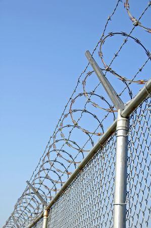 Chain Link Security Fence with Razor Wire Stock Photo - 2630457