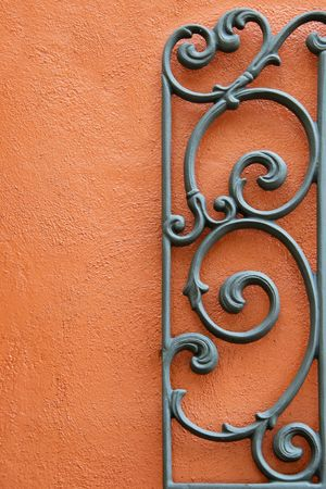 Decorative Wrought Iron Mounted to a Bright Colored Stucco Wall Stock Photo - 3446442