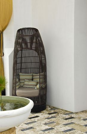 comfortable: Comfortable Wicker Chair with Soft Pillows