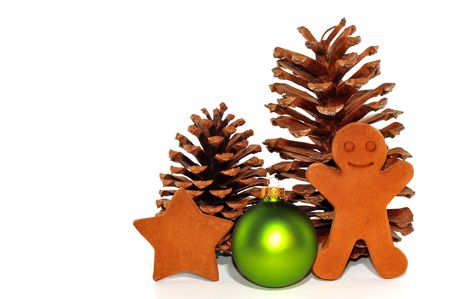 Christmas Decorations with Pine Cones and Gingerbread Men photo