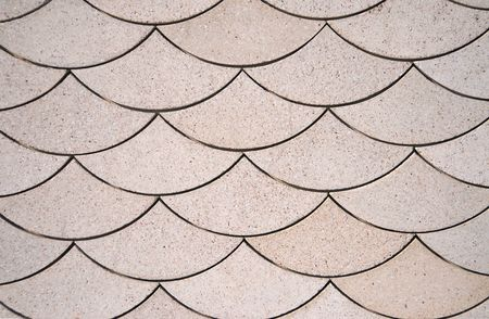wall textures: Scale Pattern cut into a Stone Wall Stock Photo