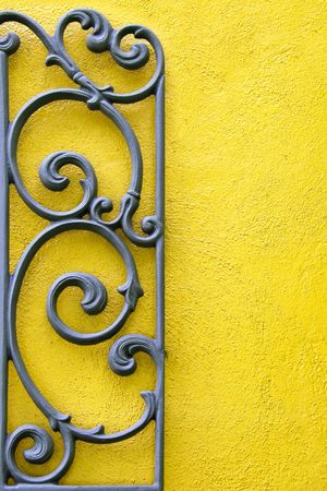 Decorative Wrought Iron Against a Bright Colored Wall Stock Photo - 5451803