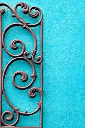 steel works: Decorative Wrought Iron against a Bright Colored Wall Stock Photo