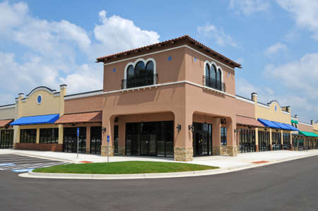 office building exterior: Store Fronts in a New Shopping Center
