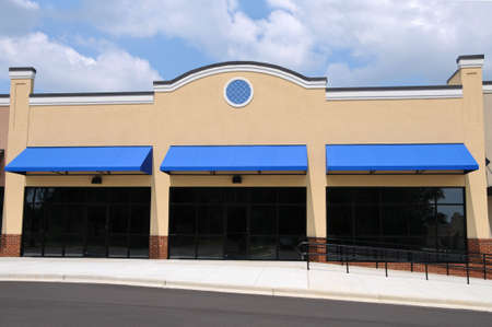 store: Store Front in a New Shopping Center Stock Photo