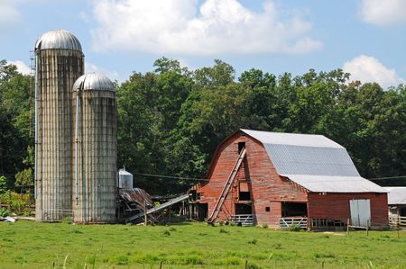 silo: Working Farm with Old Red Barn and Grain Silos