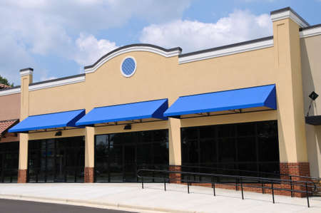 awning: Store Front in a New Shopping Center Stock Photo