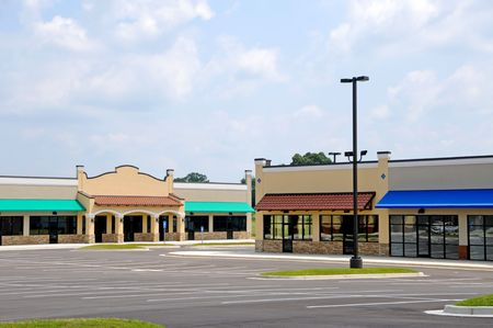 outlet store: Store Fronts in a New Shopping Center