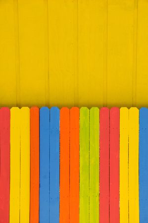 Fence painted in bright colors photo