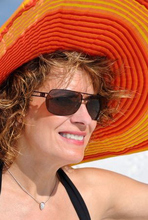 Attractive Woman Wearing a Bright Summer Hat photo