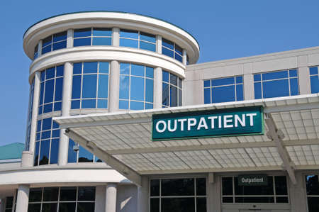 hospital sign: Outpatient Sign over a Hospital Outpatient Services Entrance Stock Photo