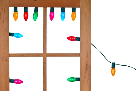 A String of Christmas Lights in the Window Stock Photo - 8252662