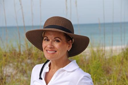 beach breast: Attractive Woman Enjoying the Beach