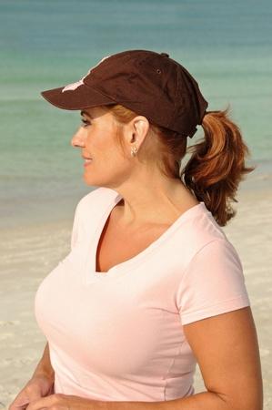beach breast: Attractive Redheaded Woman