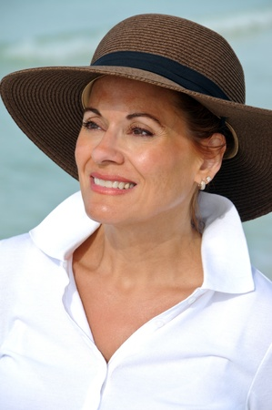 mature woman sexy: Attractive Woman Wearing Summer Hat