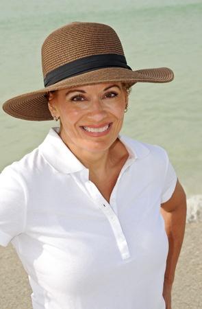 sexy mature women: Attractive Woman Wearing Summer Hat