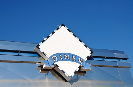 Sign on Abandoned Retro Style Diner photo