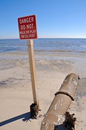 Drainage Culvert on Beach running into the Ocean Stock Photo