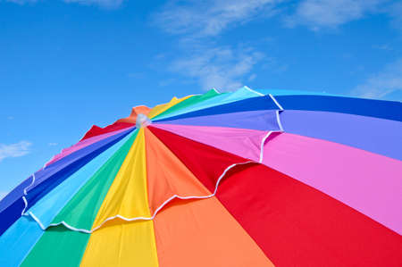 rainbow umbrella: Top of a Colorful Beach Umbrella against the Sky Stock Photo