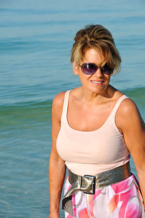 sexy mature women: Attractive Woman Walking on the Beach in a Summer Dress Stock Photo