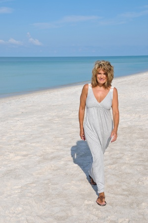 sexy mature women: Attractive Woman Walking on the Beach in a Sundress