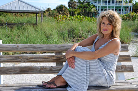 40 50: Attractive Mature Woman Sitting on a Bench