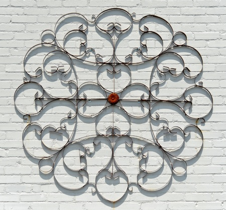 ironworks: Decorative Wrought Iron on a Painted White Brick Wall