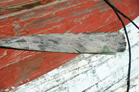 oar: Vintage Wooden Boat and Oar in Decay