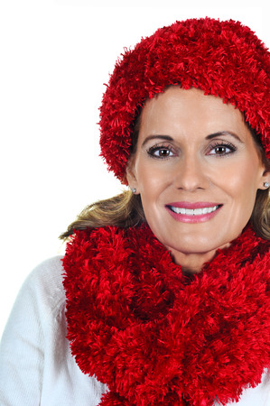 Attractive Mature Woman wearing Red Winter Hat and Scarf photo